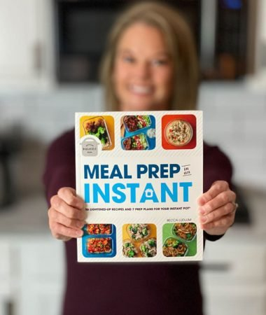 Becca holding the book Meal Prep in an Instant