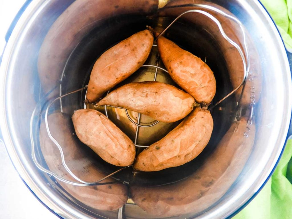 cooked sweet potatoes on a trivet in the instant pot