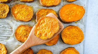 roasted sweet potato round on a wooden spatula