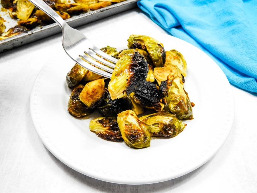 teriyaki brussels sprouts on a fork