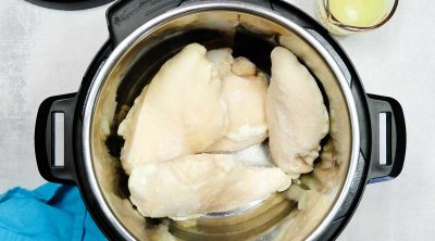 top down view of frozen chicken in an instant pot
