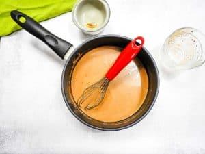 mocha creamer being heated in saucepan