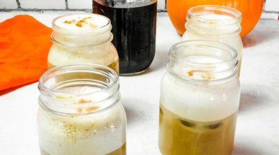 four glasses of pumpkin cream cold brew with cold foam top